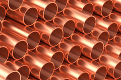 Copper pipes in rows industrial background. Heavy metallurgical industry production and non-ferrous industrial products creative abstract illustration: many Royalty Free Stock Photo