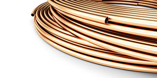 Copper pipes on a white background Royalty Free Stock Photography