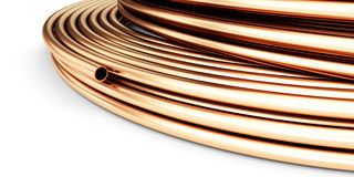 Copper pipes on a white background Royalty Free Stock Image