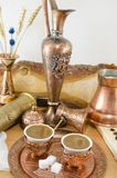 Copper plates and cups filled with coffee Royalty Free Stock Photos