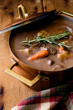 Copper Pot of Beef Stew. A copper pot filled with hearty beef stew Stock Photos