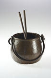 Copper pot with chopsticks Royalty Free Stock Images