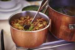 Copper pot with fried potatoes Royalty Free Stock Photo