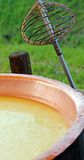 Copper pot with milk to make cheese with the old recipe Royalty Free Stock Photography