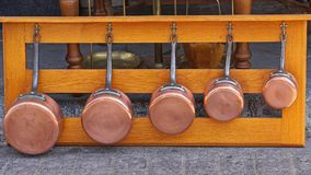 Copper pots. Cookware set at wooden shelf Stock Image