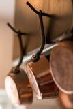 Copper pots Stock Images