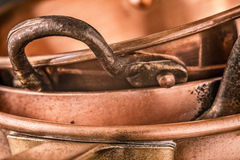 Copper pots and pans background close-up stock photos