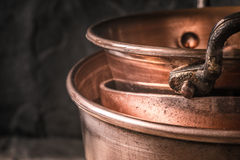 Copper pots and pans on the blurred background Royalty Free Stock Photography