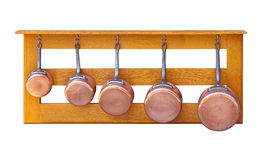 Copper pots. Copper pot cookware set at shelf isolated Royalty Free Stock Images