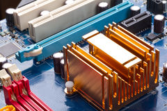 Copper radiator on motherboard Stock Photo