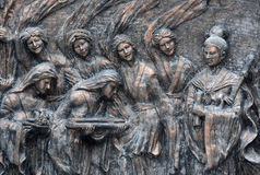Copper relief of Hakkas,asian. This embossment  describes the life of Hakkas( a patriarchal clan of China )hundreds of years ago---birthday of grandma Stock Photos