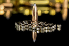 Copper rifle bullet and loading primers Royalty Free Stock Images