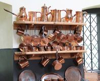 Copper Saucepans. A Display of Traditional Kitchen Copper Saucepans Royalty Free Stock Image