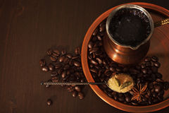 Copper set for making turkish coffee with spices coffee is ready to be served. Still life, a copper coffee set consisting of a plate, a cezve, which is a turkish Royalty Free Stock Photos
