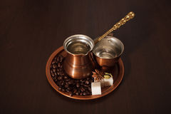 Copper set for making turkish coffee with spices. Still life, a copper coffee set consisting of a plate, a cezve, which is a turkish coffee pot, and a cup. There Royalty Free Stock Photography