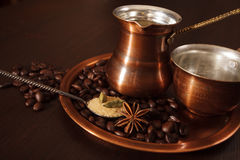 Copper set for making turkish coffee with spices. Still life, a copper coffee set consisting of a plate, a cezve, which is a turkish coffee pot, and a cup. There Royalty Free Stock Photo