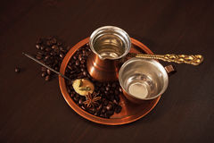Copper set for making turkish coffee with spices. Still life, a copper coffee set consisting of a plate, a cezve, which is a turkish coffee pot, and a cup. There Stock Images