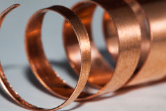 Copper shavings. A closeup shot of a rolled up copper plate Royalty Free Stock Photos