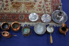 Copper and silver cookware. Various sizes and shapes stock photos