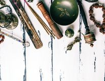 Tibetan religious objects for meditation and alternative medicin. Copper singing bowl, prayer beads, prayer drum, stone balls and other Tibetan religious objects Stock Image