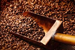 Copper spoon in coffee beans Stock Photo