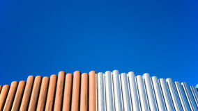Copper and Stainless steel pipes. Columns of copper and Stainless steel pipes in a blue sky background. Photo taken on January 31st, 2014 Stock Photo