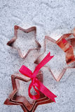 Copper star-shaped cookies cutter for Christmas on shiny mirrore Royalty Free Stock Photography