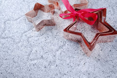 Copper star-shaped cookies cutter for Christmas on shiny mirrore Stock Image