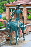 Copper statue of a man on the donkey in Sighnaghi Stock Photography