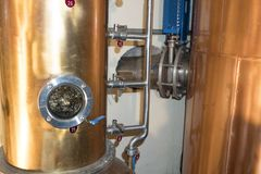 Copper still alembic inside distillery. To distill grapes and produce spirits royalty free stock photo