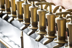 Copper tap in beer brewery Royalty Free Stock Photography