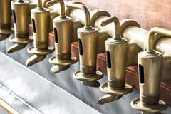Copper tap in beer brewery Stock Images