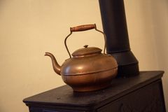 Copper tea kettle stock image