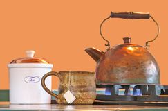 Copper Tea Kettle With Mug And Canister Stock Photo