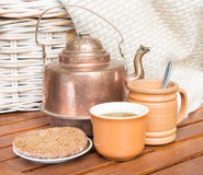 Copper teapot and couple of cups Royalty Free Stock Image