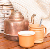 Copper teapot with cups Royalty Free Stock Photo