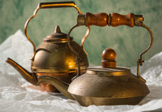 Copper teapot with dust and patina. Vintage copper teapot   on white paper,r dusty,  old, retro Royalty Free Stock Images