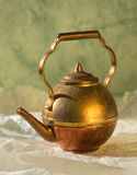 Copper teapot. Vintage copper teapot  on the white wrinkled paper Stock Image