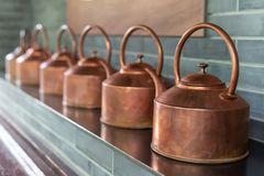Copper teapots in a row. In Chengdu, China stock image