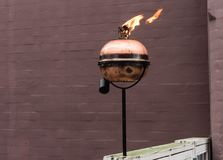 Copper torch lit on the rod. In Denmark Royalty Free Stock Image