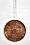 Copper tray hanged on wall. Anatolian style copper tray with hanged on white brick wall Stock Images
