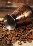 Copper Turk and coffee beans Royalty Free Stock Photo