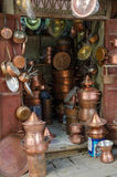 Copper ware shop with crockery, pots and pans in the metal work part of Fez` soukh, Morocco stock photo