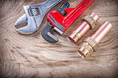 Copper water pipe nipple hose connectors monkey wrench adjustabl Stock Image