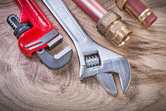 Copper water pipe wrench nipple hose connectors adjustable spann Stock Photo