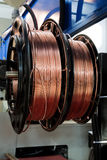 Copper wire. Shiny copper wire on spools in the shop Stock Images