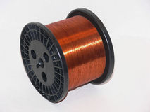 Copper wire. A roll of very fine copper wire on a black plastic roll Royalty Free Stock Images