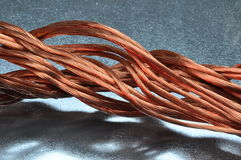 Copper wire on metal surface Stock Photo