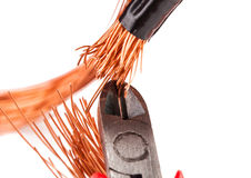 Copper wire with pliers isolated Royalty Free Stock Photos