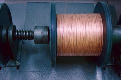 Copper wire reel. Copper wire on a reel at manufacturing. Landscape orientation Royalty Free Stock Images